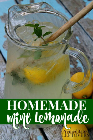 homemade mint lemonade in a pitcher with lemon slices and fresh mint