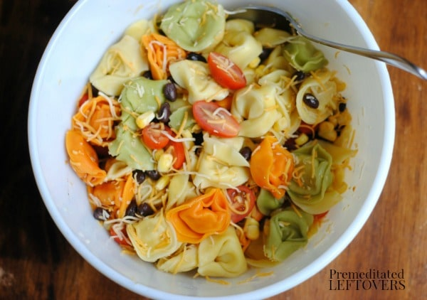 Gently stir the ingredients for the Southwest Ranch Tortellini Salad recipe