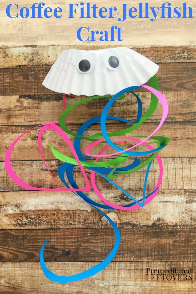 Coffee Filter Jellyfish Craft for Kids- This cute jellyfish is made with coffee filters and card stock. It is a fun and easy craft to make with your kids.