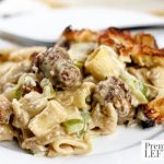 Creamy Cheese and Brat Casserole- This budget-friendly recipe combines creamy Alfredo sauce with pasta and bratwurst to make a hearty meal in under an hour.