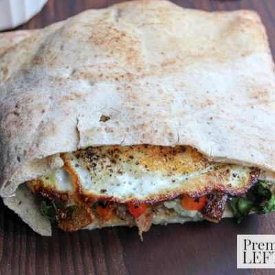 Pita Breakfast Sandwich- Breakfast on the go just got a whole lot easier with these pita sandwiches loaded with beef, veggies, and eggs!