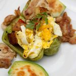 Stuffed Breakfast Peppers- Use leftovers to make this delicious breakfast recipe. Green peppers are loaded with eggs, veggies, potatoes, and chicken.