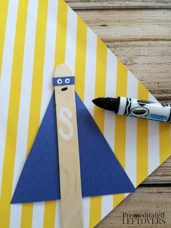 Superhero Sticks Craft for Kids drawing eyes