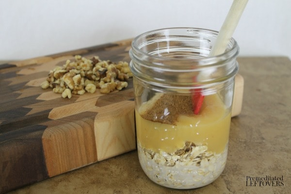 Apple Pie Overnight Oatmeal - add almond milk, applesauce and spices.