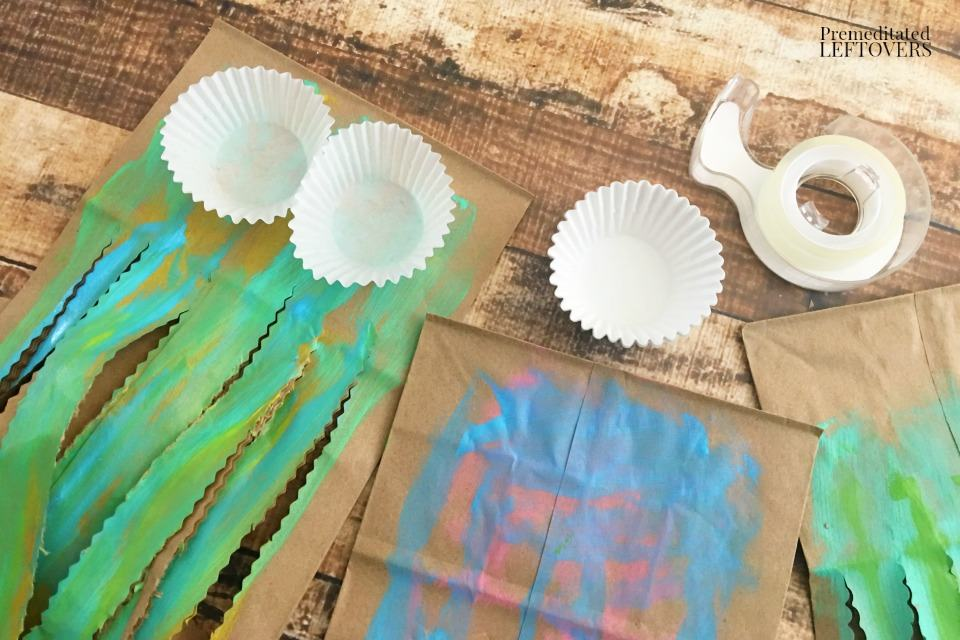 Paper Bag Jellyfish Craft - taping cupcake liners to painted bags