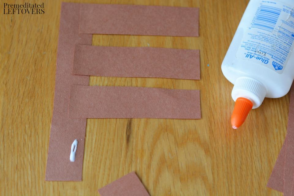 Apple Stamping Craft- glue short strips to long strip