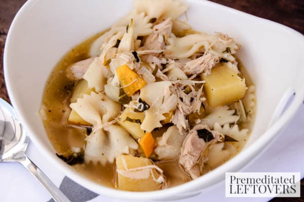 Best Homemade Chicken Soup with Bowtie Pasta- serving of soup in bowl
