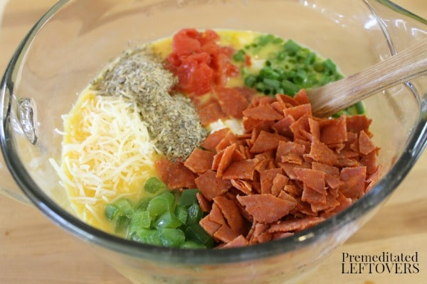 Add the cheese, cottage cheese, pepperoni, tomatoes, bell pepper, onion, and Italian seasoning mix to the eggs.