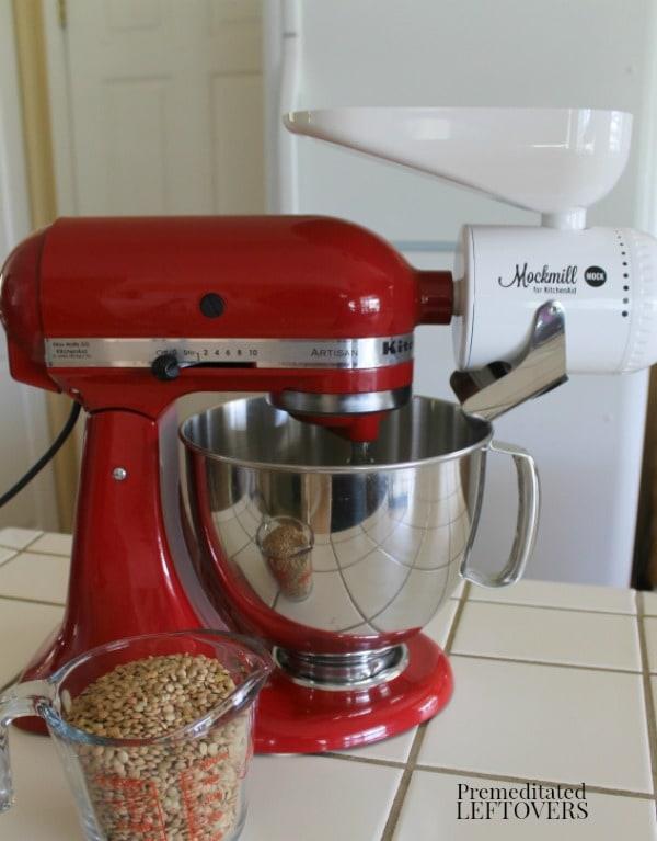 Preparing to make lentil flour using a grain mill