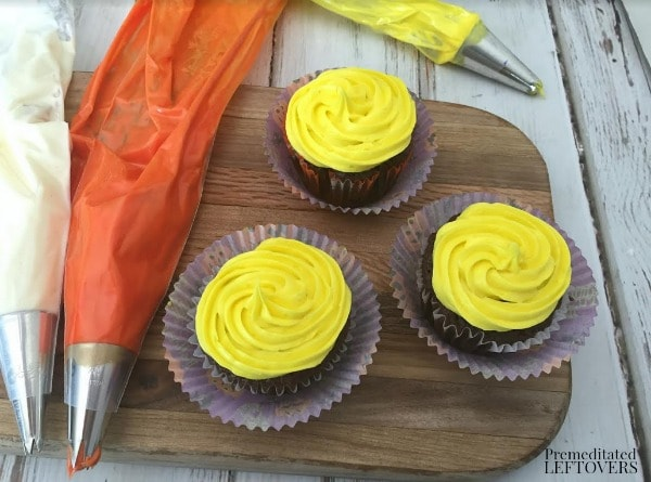 Easy Candy Corn Cupcakes- add yellow frosting first