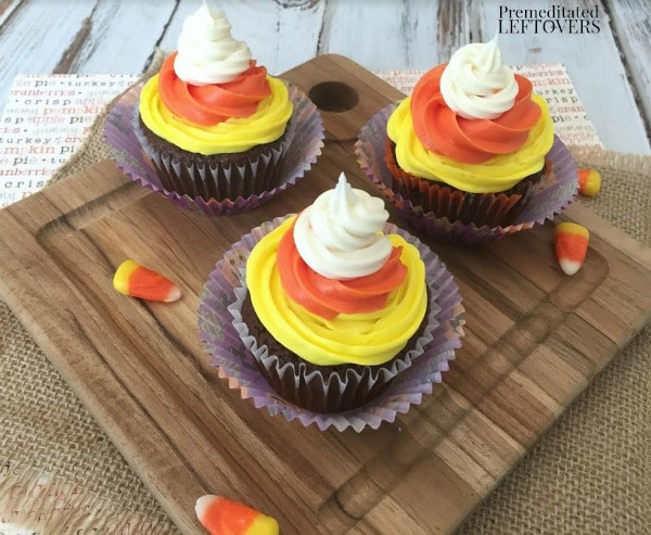 Easy Candy Corn Cupcakes- These delicious and easy to make cupcakes resemble candy corn! They are the perfect treat to bring to get togethers this fall.