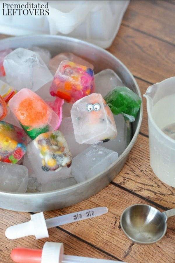 Ice Cube Discovery Activity for Kids- empty cubes into bowl