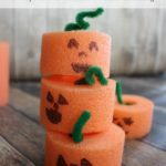These Pool Noodle Pumpkins are an easy and frugal fall craft for kids. Pool Noodle Pumpkins can also be used for learning activities and imaginative play.