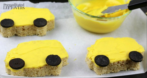 School Bus Rice Krispie Treats- cover evenly with chocolate and add cookie wheels