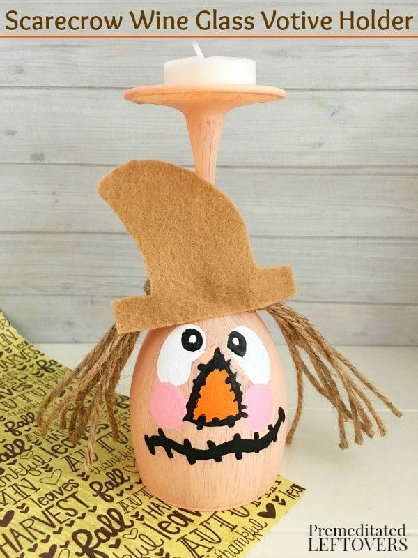 This DIY Scarecrow Wine Glass Votive Holder is a great fall craft. It's an inexpensive way to decorate your table with a pretty tea light candle.