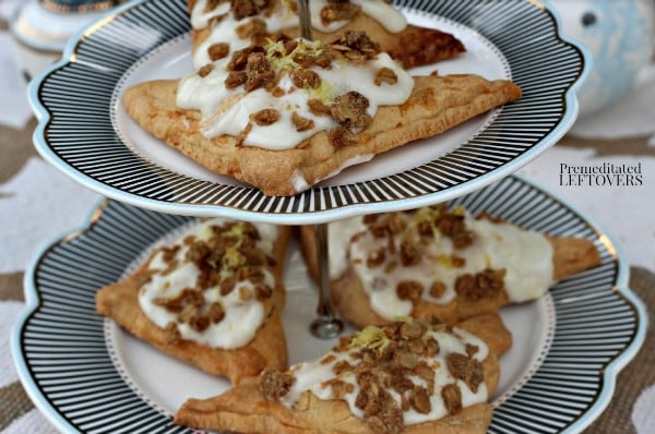 These Blueberry Hand Pies with Lemon Cream Icing and Oat Crunch are a delicious dessert made with fresh fruit. Serve them with brunch or tea with friends.
