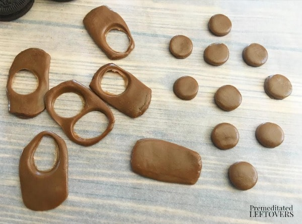 Mickey Mouse Chocolate Dipped Oreo Cookies- cut out tootsie roll circle