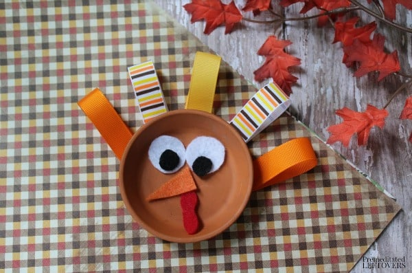 Reuse a terra cotta saucer to make this colorful Flower Pot Saucer Turkey Craft. It is an easy and frugal craft to make with kids this fall.
