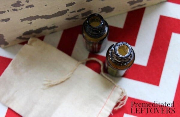 0 Recipes for Upcycling Your Essential Oil Bottles- glass essential oil bottles and linen sachet