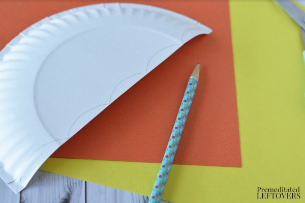 Paper Plate Umbrella- cut plate and draw scallop on edges