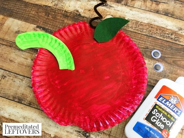 paper plate apple craft for kids- glue on googly eyes