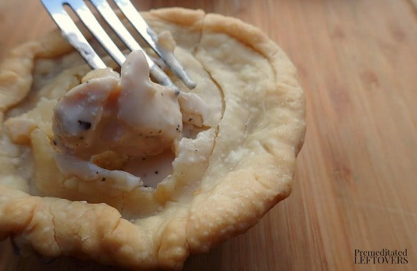 Chicken Alfredo Mini Pot Pie Recipe- fork in baked pot pie