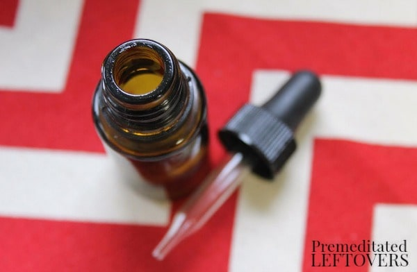 10 Recipes for Upcycling Your Essential Oil Bottles- essential oil bottle and dropper