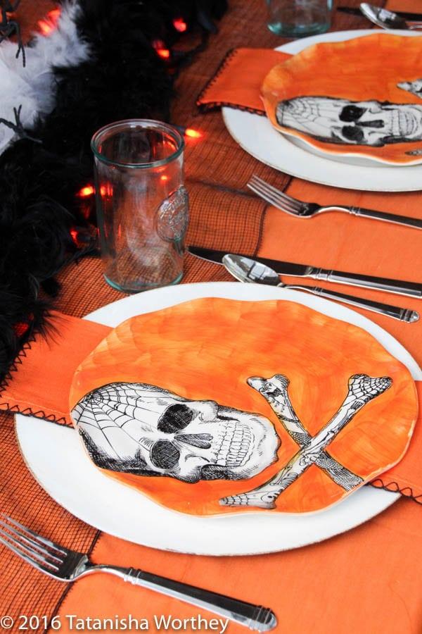 Orange and Black Skeleton Halloween Tablescape- orange skeleton dinner plates