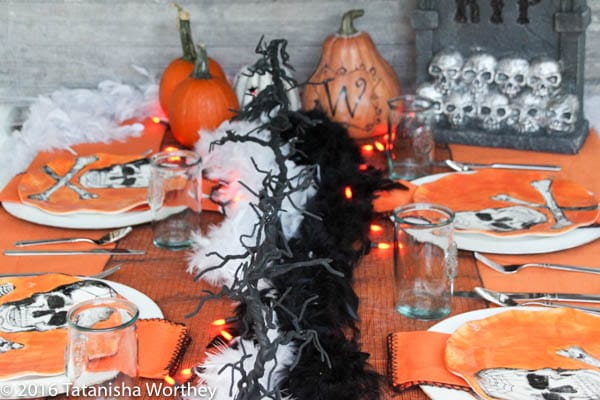 Orange and Black Skeleton Halloween Tablescape- decorated dinner table