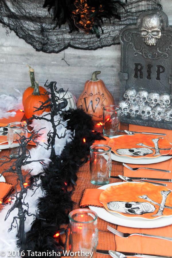 Orange and Black Skeleton Halloween Tablescape- black and white boas on Halloween table