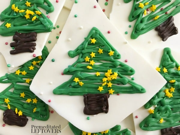 Making Christmas Tree Chocolate Bark is easily one of my favorite fun ways to celebrate the holiday season.  It breaks apart easily to create bite-sized chocolate bark treats that everyone will love seeing on your holiday dessert buffet!