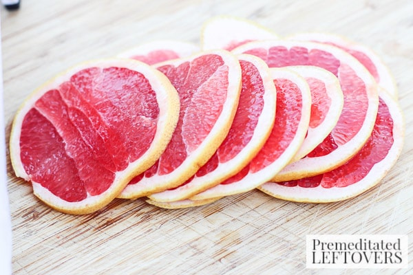Grapefruit and Pomegranate Punch with Rosemary- sliced grapefruit