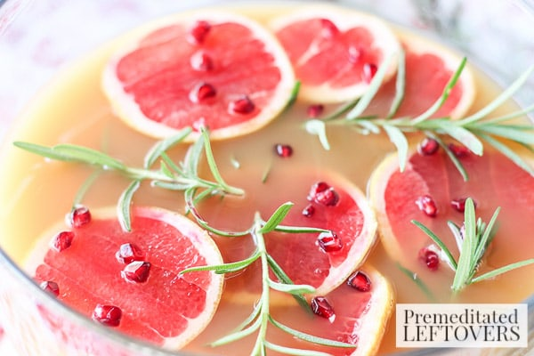 Grapefruit and Pomegranate Punch with Rosemary- punch bowl garnished with rosemary