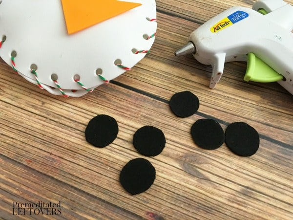 Foam Snowman Craft- glue black circles for coal buttons