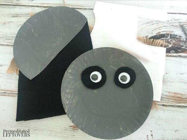 Raccoon Paper Plate Craft- affix googly eyes
