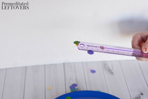 Easy Static Electricity Experiment- hold ruler above plate of confetti
