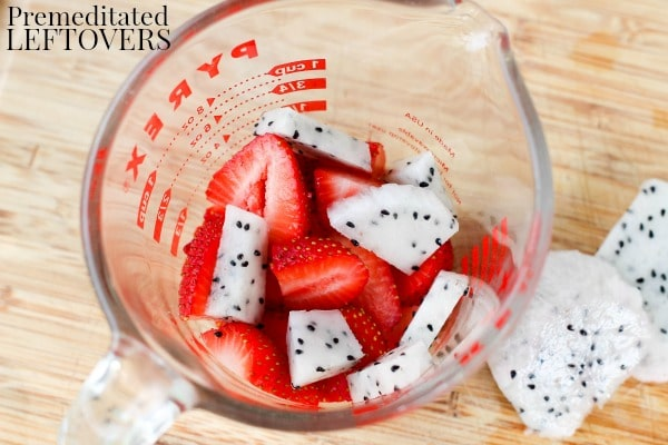 Strawberry Oatmeal Chocolate Smoothie- dragon fruit and strawberries in a measuring cup