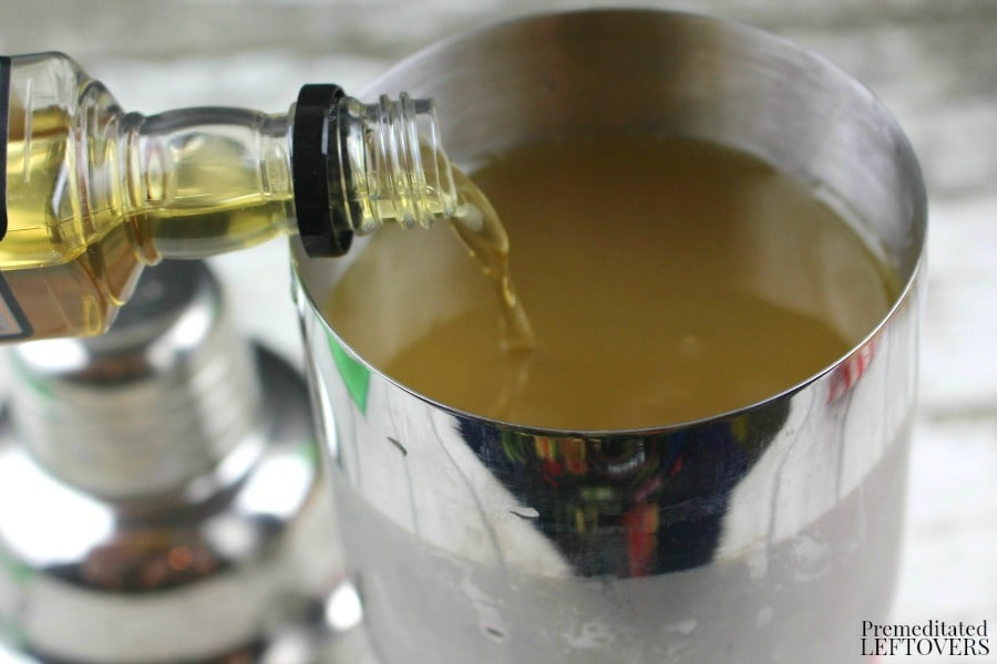 Apple Cider Bourbon Cocktail- pouring bourbon into shaker