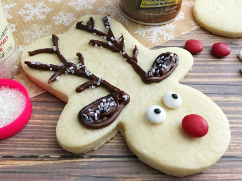 These Rudolph Sugar Cookies are made with a gingerbread man cookie cutter! It's an easy cookie recipe to bake and decorate this Christmas.