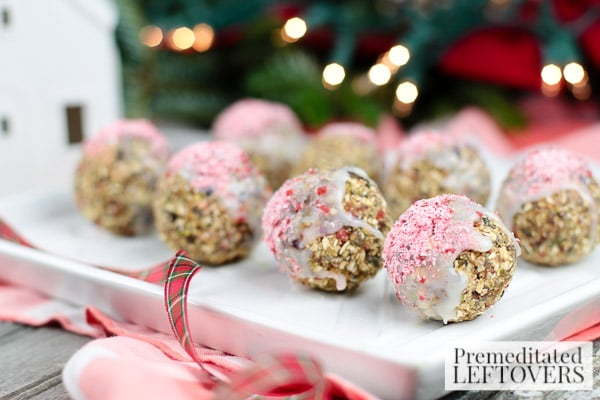Now comes the fun part. The finished snack balls get dipped into melted white chocolate and sprinkled with crushed peppermint candy canes. If that doesn't put a smile on your mug then I don't think you're really in the holiday mood.