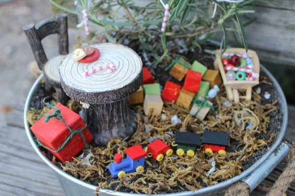 Kids will love making this Christmas Fairy Garden to celebrate the magic and wonder of the holiday! It's simple to create with fun Christmas miniatures.