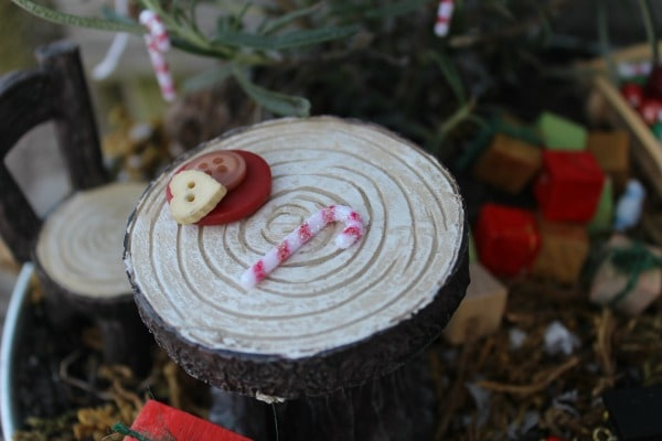 christmas fairy garden-table with buttons and candy cane