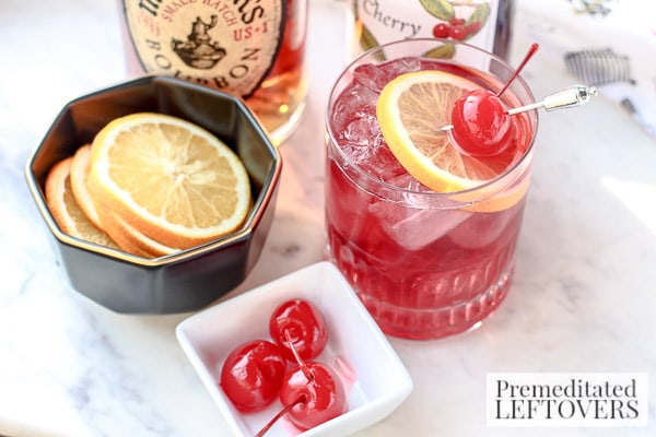 Beat the winter blahs with this Bourbon and Cherry Cocktail! It's a refreshing recipe with Bourbon, Maraschino cherries, and a splash of citrus.