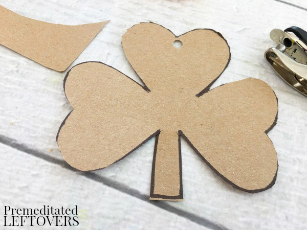 Irish Shamrock Yarn Craft is a great simple fine motor skills idea for kids to make for St. Patrick's Day! Yarn crafts are tons of fun and easy to make!