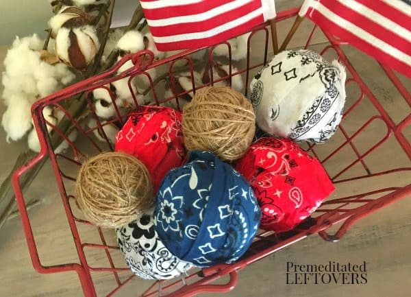 Basket of DIY twine balls and patriotic rag ball using red, white, and blue bandanas.