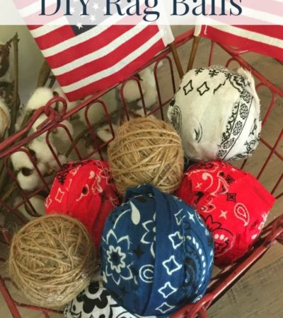DIY Americana rag balls usingred, white, and blue bandannas in a wire basket