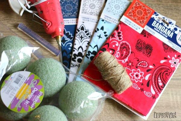 supplies needed to make Patriotic Rag Balls: foam balls, bandanas, twine, and hot glue.