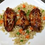 Sous Vide Honey Garlic Chicken Wings Recipe served on cauliflower fried rice.