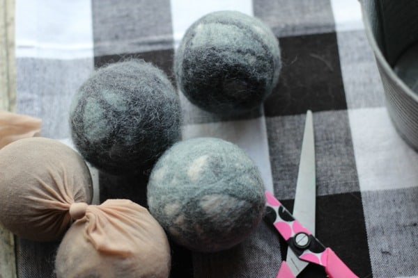 homemade wool dryer balls that are not felted wool after being cut out of the pantyhose.