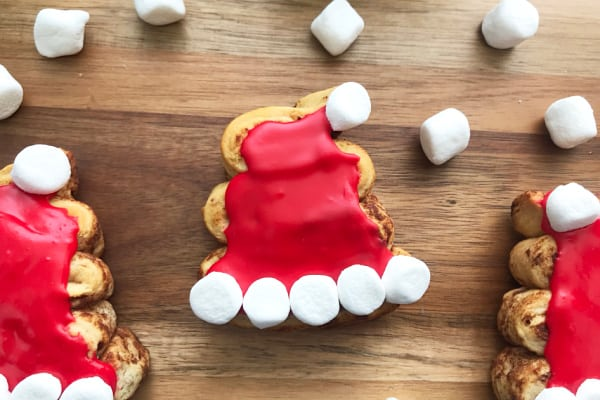 Quick and easy cinnamon rolls shaped to look like Santa's Hat.